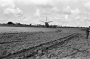 29/03/1963<br /> 03/29/1963<br /> 29 March 1963<br /> B.E.A. Aircrash at Dublin Airport. The crashed BEA Vanguard G-APEJ that carried 43 passengers and seven crew from London to Dublin ploughed its way through half a mile of grassland before returning to the concrete runway, when its front undercarriage appeared to have failed on arrival at Dublin Airport. There were no fatalities in the accident. The path of the aircraft can be seen in the trail of earth across the runway. Photos, Photo, Snap, Streets, Street,