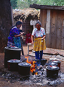 Women in Carla's Camp cooking traditional foods over an open fire, Carla Goseyun's White Mountain Apache Traditional Sunrise Ceremony, July 7-9, 1990, Whiteriver, Arizona.  Please Note: A small extra licensing fee needs to be paid to the Goseyun Family for usage of this photo. Contact Fred Hirschmann for more information. Thanks.