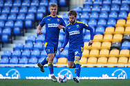 AFC Wimbledon attacker Shane McLoughlin (19) passing the ball during the EFL Sky Bet League 1 match between AFC Wimbledon and Hull City at Plough Lane, London, United Kingdom on 27 February 2021.