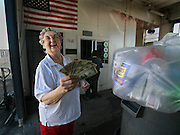 Becky Smith 72, shows off the money she received for her recyclables at the America's Recycle Center in Carmichael, Wednesday, August 20, 2008. Wednesdays are senior citizen days at the Carmichael business where the seniors get an extra 5 cents per pound for recyclables. With the economy worring so many people about not having enough, business is booming at this Carmichael recycling business. Lines of homeless people pushing shopping carts filled with bottles and cans are being replaced with soccer moms driving SUVs filled with the recyclables. In a year's time, the owners of this recycling center report that their business has doubled. The Department of Conservation, which regulates recycling centers, reports that the recyling rate across the state has increased 10 percent.