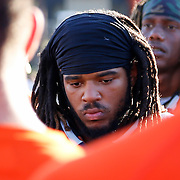 On Saturday, November 5, Melvin Irby (34) listens to his coach speak after a tough loss against  Fullerton College's football team in Costa Mesa, CA. Fullerton won with the final score of 35 to 14.<br /> <br />  Photograph taken by ©Mikailin Rae Perry, Sports Shooter Academy