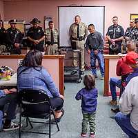 051515       Cable Hoover<br /> <br /> Ramah Navajo Police chief Darren Soland, center, introduces officers from his department, Ramah Corrections and N.M. State Police to a local crowd during the Ramah Navajo Justice Day in Mountain View Friday.