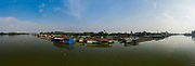 Panorama of floating fish farming community in Bien Hoa on the Dong Nai river, Vietnam on a sunny day