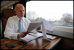 Foreign Secretary William Hague working on the train whilst on his way to his Constituency office in the North East, Wednesday February 4, 2010. Photo By Andrew Parsons / i-Images.