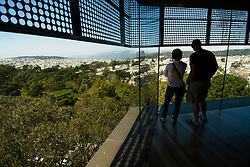 California: San Francisco. Couple in tower at De Young Museum in Golden Gate Park. Photo copyright Lee Foster. Photo #: 24-casanf83940