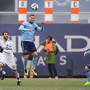 NEW YORK, NEW YORK - March 18: Maxime Chanot #4 of New York City FC heads clear from Ignacio Piatti #10 of Montreal Impact during the New York City FC Vs Montreal Impact regular season MLS game at Yankee Stadium on March 18, 2017 in New York City. (Photo by Tim Clayton/Corbis via Getty Images)