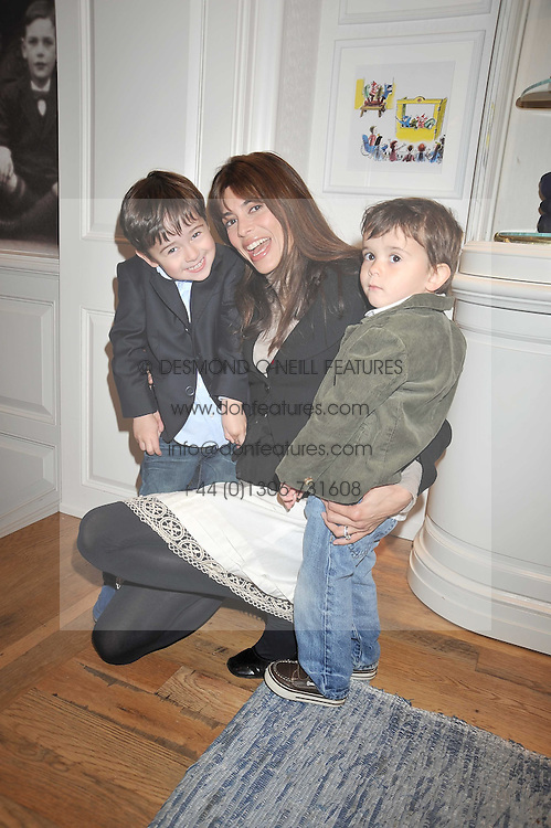 LISA BILTON and her sons left ORLANDO and right NOAH at 'Paint Your Polo Celebration' a children's party in aid of the charity Clic Sargent held at Ralph Lauren, 139/141 Fulham Road, London on 28th April 2009.