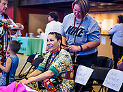 06 MAY 2017 - ST. PAUL, MN: MARY RAINEY (back) helps CAROLYN GOUGE, from Red Cliff Lake Superior Ojibway band, get ready for the 6th Annual Powwow for Hope at Ft. Snelling in St. Paul. The powwow was a fundraiser to support cancer education and supportive services for American Indian communities. Proceeds benefited the American Indian Cancer Foundation's work to eliminate cancer burdens on American Indian families. Cancer is the leading cause of death in Native American communities, exceeding coronary disease and diabetes.       PHOTO BY JACK KURTZ