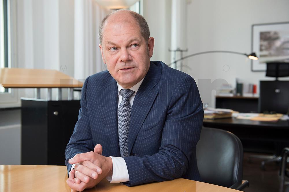 25 JUN 2018, BERLIN/GERMANY:<br /> Olaf Scholz, SPD, Bundesfinanzminister, waehrend einem Interview, in seinem Buero, Bundesministerium der Finanzen<br /> IMAGE: 20180625-02-017<br /> KEYWORDS: Büro