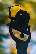 Silhouette of a cast iron bell, September, Schoolcraft Lake, Hubbard County, Minnesota, USA
