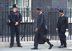 © Licensed to London News Pictures. 23/05/2015. London, UK. President of Nigeria, General Muhammadu Buhari, left, arrives at 10 Downing Street, central London, to meet British Prime Minister David Cameron. Photo credit : Isabel Infantes/LNP