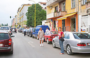 Street scene with cars, pedestrians and typical colourful houses. Tirana capital. Albania, Balkan, Europe.