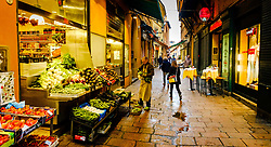 Preparing a fruit and vegetable stall in the early morning in Bologna, Italy<br /> <br /> (c) Andrew Wilson | Edinburgh Elite media