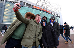 Brighton and Hove Albion fans pose for a selfie ahead of the Emirates FA Cup, quarter final match at Old Trafford, Manchester