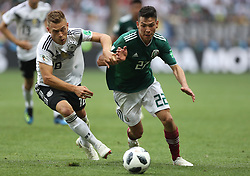 MOSCOW, June 17, 2018  Joshua Kimmich (L) of Germany vies with Hirving Lozano of Mexico during a group F match between Germany and Mexico at the 2018 FIFA World Cup in Moscow, Russia, June 17, 2018. (Credit Image: © Xu Zijian/Xinhua via ZUMA Wire)