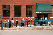 24 OCTOBER 2020 - DES MOINES, IOWA: People wait in line to cast their early votes at the Polk County Auditor's office. Early vote turnout in Polk County has already exceeded 2016's total. Democrats and Republicans held rival Get Out the Vote (GOTV) events in Des Moines Saturday. Democrats and the Biden/Harris campaign held a voter registration and early balloting events at a Mexican grocery store to mobilize the Latino community and then marched to the Polk County Auditor's Office to support early voting efforts. Supporters of President Trump participated in a motorcade that drove through Des Moines flying Trump 2020 flags and honking their car and truck horns.     PHOTO BY JACK KURTZ