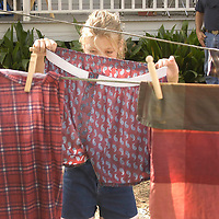 Alex Reyes, 9, of Seabrook tries to figure out how to hang up the boxers she just hand washed on a wash board during the annual Martyn Farm Fall festival held at Armand Bayou Nature Center as they step back in time to the early 1900's.<br />   (Photo by Kim Christensen)