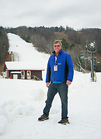 General Manager Greg Goddard stands Magic Carpet base with snow covering the Tiger Trail as Gunstock Mountain prepares for opening day on Friday, November 29th.  (Karen Bobotas/for the Laconia Daily Sun)