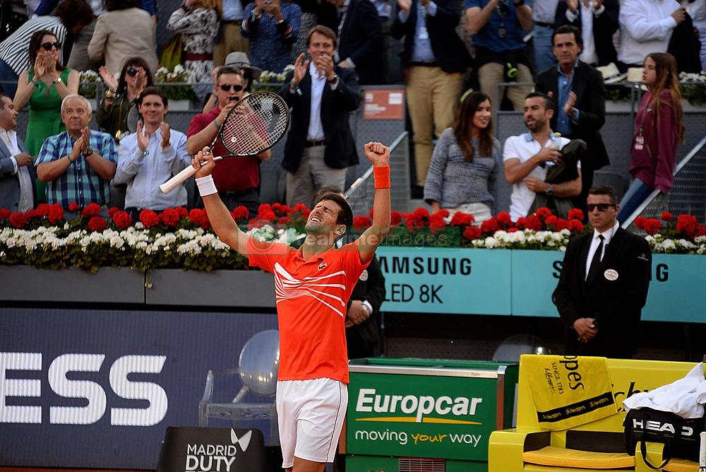 May 12, 2019 - Madrid, Spain - Novak Đoković of Croatia celebrates after defeating Stefanos Tsitsipas of Greece in the Madrid Open final during day nine of the Mutua Madrid Open at La Caja Magica in Madrid on 12nd May, 2019. (Credit Image: © Juan Carlos Lucas/NurPhoto via ZUMA Press)