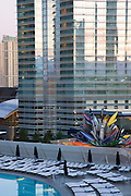 The Vdara pool with the Aria Resort and Casino in the background, City Center, Las Vegas, Nevada.