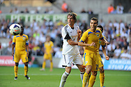 Michu of Swansea City alongside Guilherme of Petrolul Ploiesti<br /> UEFA Europa league, play off round, 1st leg match, Swansea city v FC Petrolul Ploiesti at the Liberty stadium in Swansea on Thursday 22nd August 2013. pic by Phil Rees , Andrew Orchard sports photography,