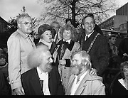 "Molly Malone Statue Unveiled. (R93)..1988..20.12.1988..12.20.1988..20th December 1988..""Dublin's Fair City"" received a millenniun gift to commemorate her most famous daughter, Molly Malone, when Jurys Hotel Group plc presented a specially commissioned sculpture to the people of Dublin. The sculpture was formally handed over by Michael McCarthy, MD,Jurys Hotel Group, to the Lord Mayor of Dublin, Councillor Ben Briscoe, TD, in an unveiling ceremony today at the corner of Grafton Street, Suffolk Street and Nassau Street..Molly Malone was created and fashioned in her traditional 17th century dress by Dublin born artist, Jeanne Rynhart, who was selected from a number of entries for the statue design, by the Dublin Millennium Board...Picture shows Alice Glenn TD taking over the mike at the unveiling of the Molly Malone statue..(L-R) Michael Mc Carthy, Eamonn Campbell, Jeanne Rynhart, john Sheehan and Ben Briscoe."