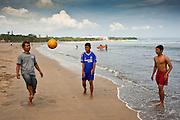 Apr 24 - KUTA, BALI - Indonesians play with a soccer ball on Kuta beach, one of Bali's most famous beaches in Kuta, Bali, Indonesia. Photo by Jack Kurtz