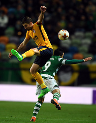 LISBON, April 13, 2018  Marcos Acuna (R) of Sporting vies with Gabi of Atletico during the Europa League quarterfinal second leg soccer match between Sporting CP and Club Atletico de Madrid at the Jose Alvalade stadium in Lisbon, Portugal, on April 12, 2018. Sporting won 1-0 but was eliminated by a 1-2 aggregate. (Credit Image: © Zhang Liyun/Xinhua via ZUMA Wire)