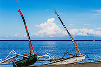 Nusa Tenggara, Lombok, Senggigi. Traditional sail vessels on West Lombok. Bali in the background with Gunung Agung.