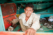 Sept. 24, 2009 -- PATTANI, THAILAND: A worker takes a break below the decks of a fishing boat being rebuilt in Siriudom Shipyards in Pattani, Thailand. Fishing is the main industry in Pattani, one of just three Thai provinces with a Muslim majority. Thousands of people, mostly Buddhist Thais and Burmese Buddhist immigrants, are employed in the fishing industry, either crewing ships, working in processing plants or working in the ship building and refreshing yards.   Photo By Jack Kurtz / ZUMA Press