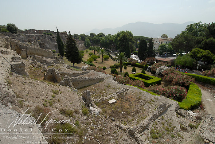 Gardens growing along the edge of the ruins of Pompei, Italy