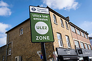 Transport for Londons TFL new signposts for the new Ultra Low Emissions Zone ULEZ have been erected around the inner orbital road perimeter around the capital, and seen on the South Circular in Forest Hill on the day that the new area becomes effective for newer vehicles, on 25th October 2021, in London, England. Now 18 times larger, the new ULEZ area bans older vehicles such as polluting diesels and petrol cars older than 2006, an attempt to lower poisonous emissions that further harm the health of 1 in 10 children who have asthma. Drivers of non-exempt vehicles may enter the ULEZ after paying a £12.50 daily fee - or face a £160 penalty.