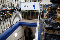 © Licensed to London News Pictures. 31/05/2016. London, UK. Members of public use a public toilet in central London on 31 May 2016. A BBC investigation shows that some UK High Streets and public spaces no longer have any council-run public toilets and nearly 1,800 public toilets closed nationwide in the last 10 years. Photo credit: Tolga Akmen/LNP