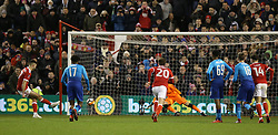 Nottingham Forest's Ben Brereton (left) scores his side's third goal of the game from the penalty spot