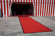 A red carpet and red and white striped marquee is seen after a military event at the Guildhall in the City of London, the capital's financial district and historic heart. There are imperfections because boot marks on the end  many people have already walked over the material. The Guildhall has been an important centre for City of London affairs since the twelfth century. 800 years on, Guildhall is still home of the City of London Corporation, and acts as a grand setting for glittering banquets in honour of visiting Heads of State and other dignitaries, royal occasions, and receptions for major historical anniversaries.