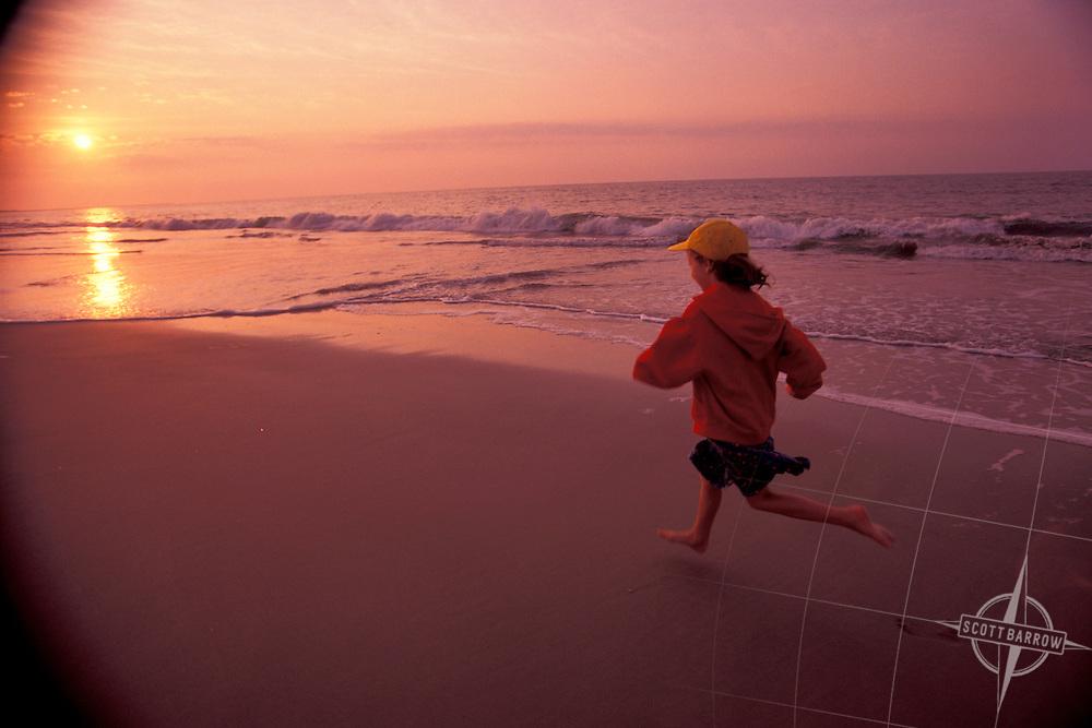 Child Running, Beach at sunset.