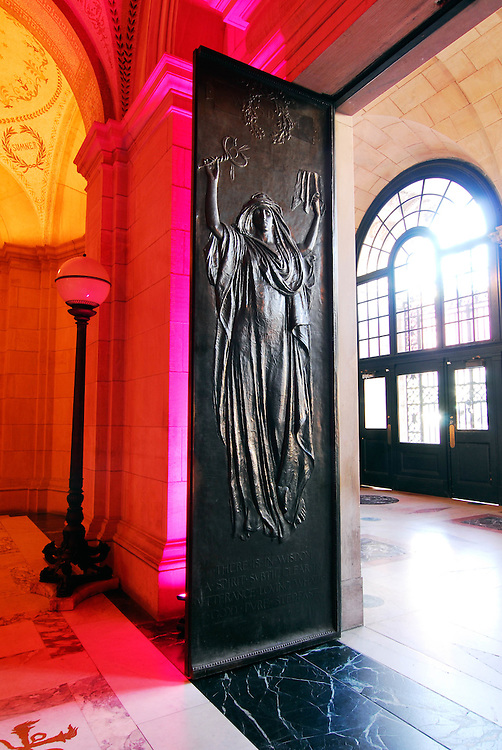 The afternoon sun highlights the relief sculpture on the doors of the Boston Public Library.