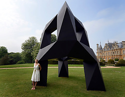 © Licensed to London News Pictures. 24/05/2012. Waddesdon, UK. Kathryn Hobbs leans on a sculpture by John Pawson. People enjoy the warm weather amongst an exhibition of contemporary sculpture at Waddesdon Manor, Buckinghamshire, today 24th May 2012. The exhibition is being held by Christie's as part of a private sale. Photo credit : Stephen Simpson/LNP