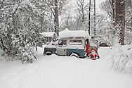 A 1967 Landrover decorated for Christmas during a 17inch snow storm in Alexandria, Virginia  photograph by Dennis Brack