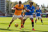 Tony Watt (Motherwell) keeps possession from Calvin Bassey (Rangers) during the Scottish Premiership match between Motherwell and Rangers at Fir Park, Motherwell, Scotland on 27 September 2020.