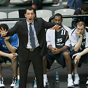 Efes Pilsen's coach Ufuk SARICA (F) during their Turkish Basketball league derby match Besiktas between Efes Pilsen at the BJK Akatlar Arena in Istanbul Turkey on Saturday 30 April 2011. Photo by TURKPIX
