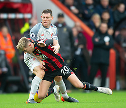 Liverpool's James Milner tackles Bournemouth's David Brooks during his 500th Premier League appearamce in the Premier League match at the Vitality Stadium, Bournemouth.