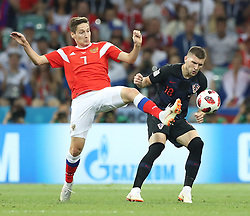 SOCHI, July 7, 2018  Daler Kuziaev (L) of Russia vies with Ante Rebic of Croatia during the 2018 FIFA World Cup quarter-final match between Russia and Croatia in Sochi, Russia, July 7, 2018. (Credit Image: © Xu Zijian/Xinhua via ZUMA Wire)