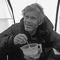 Rick Ridgeway eats a granola breakfast during an expedition to Queen Maud Land, Antarctica.