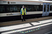 A train guard stands within a two metre marked area on 6th April 2020 in London, United Kingdom. There have been almost 50,000 reported cases of the COVID-19 coronavirus in the United Kingdom and almost 5,000 deaths. The country is in its third week of lockdown measures aimed at slowing the spread of the virus.