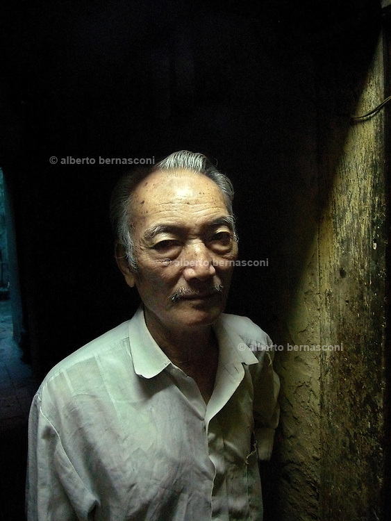 Vietnam, Hanoi: old man living in a ancient house of Hanoi