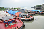 SUZHOU, CHINA - JULY 04: <br /> Ships carrying waste berth at a dock in the Taihu National Tourism Vacation Zone on July 4, 2016 in Suzhou, Jiangsu Province of China. Police seized 8 ships which loaded about 4,000 tons of suspected household garbage from Shanghai and arrived at a dock in Suzhou on July 1. Over 20,000 tons of waste was found on the bank within a drug rehabilitation center at the Suzhou Taihu National Tourism Vacation Zone.<br /> ©Exclusivepix Media