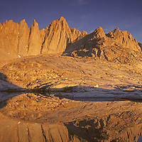 14,505-foot Mount Whitney, the highest peak in the contiguous USA, reflects in a tarn in the John Muir Wilderness, Sierra Nevada, California.