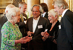 Britain's Queen Elizabeth II talks to Dame Judi Dench and Anish Kapoor (centre) during a reception for the Praemium Imperiale Awards at Buckingham Palace in central London.