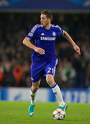 LONDON, ENGLAND - Wednesday, December 10, 2014: Chelsea's Nemanja Matic in action against Sporting Clube de Portugal during the final UEFA Champions League Group G match at Stamford Bridge. (Pic by David Rawcliffe/Propaganda)